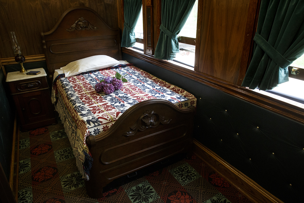 Period furniture was purchased for use in the sleeping room of the re-built Lincoln Funeral Car. Carpet was specially woven for the floor and the walls are covered with tufted green upholstery. Ted Schurter/The State Journal-Register