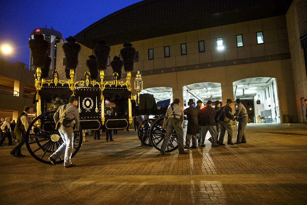 Re-enactors roll the Lincoln hearse up to Springfield's Fire Station One after the all night vigil that was to be the final event of Saturday's Lincoln funeral re-enactment was adjusted due to potential overnight rain showers. Ted Schurter/The State Journal-Register
