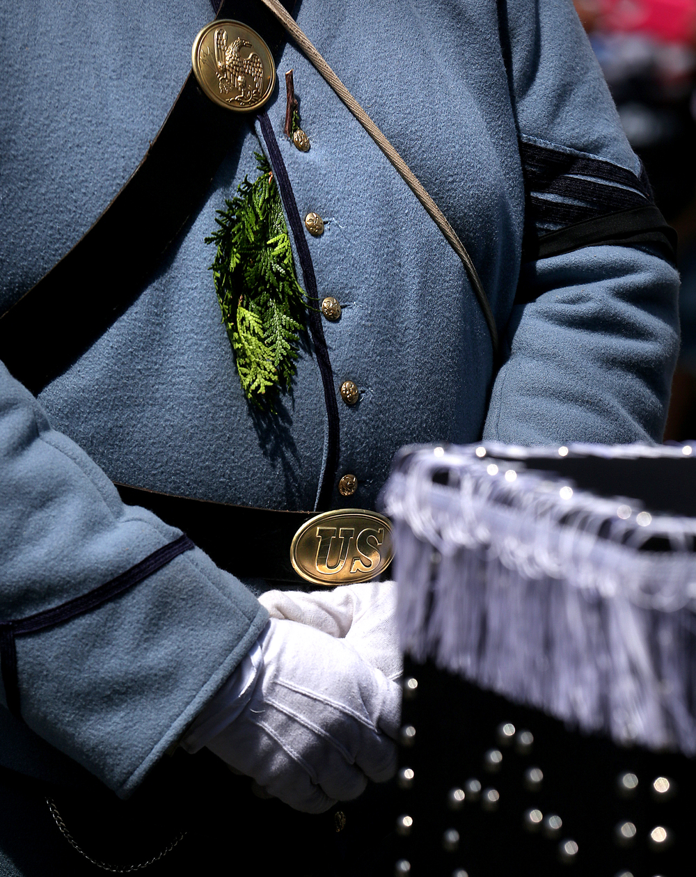 Marcus Petrella, 8th Veteran Reserve Corps, wears a sprig of evergreen tucked between the buttons of his coat. Petrella helped move the Lincoln coffin into the hearse at the conclusion of the vigil Sunday morning. David Spencer/The State Journal-Register