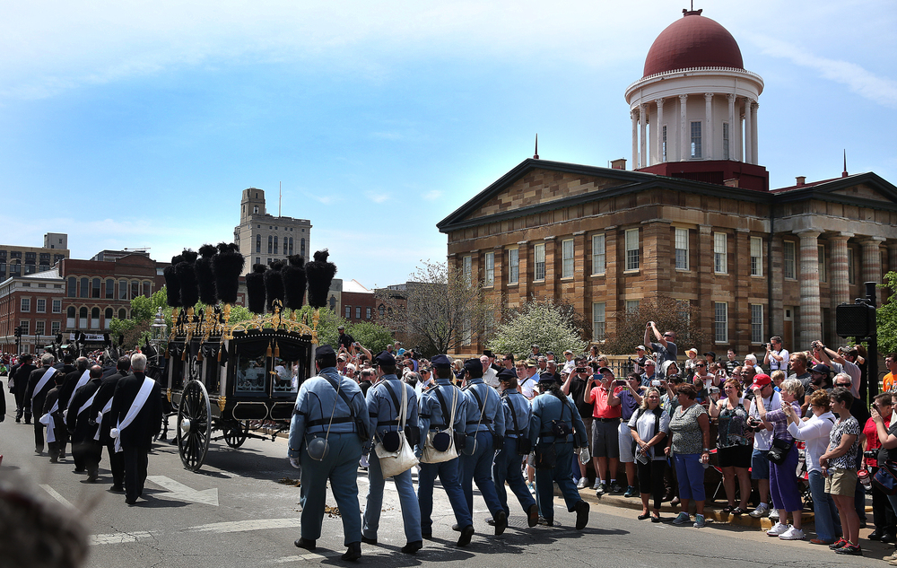 Members of the Eighth Veterans Reserve Corps follow behind the Lincoln hearse as it sets out south on Sixth Street past the Old State Capitol Sunday. David Spencer/The State Journal-Register