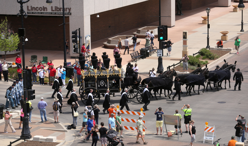 The funeral hearse turns the corner of Capitol Avenue and Seventh Street. David Spencer/The State Journal-Register