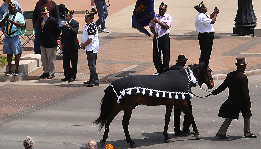 "Myrel Simmons of Springfield, leads a horse representing ""Old Bob,"" which was owned by Lincoln and walked in the funeral procession 150 years ago. Simmons was portraying the historical figure Rev. Henry Brown. David Spencer/The State Journal-Register"