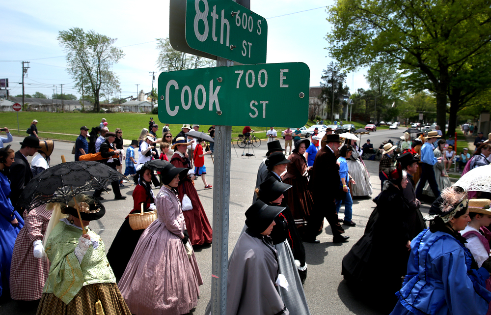 Historical re-enactors walk west on Cook Street after walking through the Lincoln Home neighborhood. David Spencer/The State Journal-Register