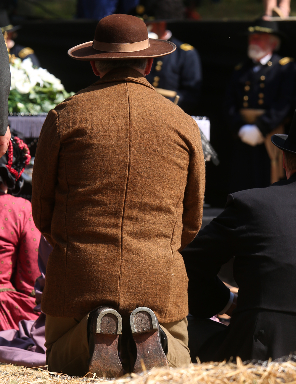 A re-enactor kneels in front of the coffin during the funeral service at the receiving vault Sunday at Oak Ridge Cemetery. David Spencer/The State Journal-Register