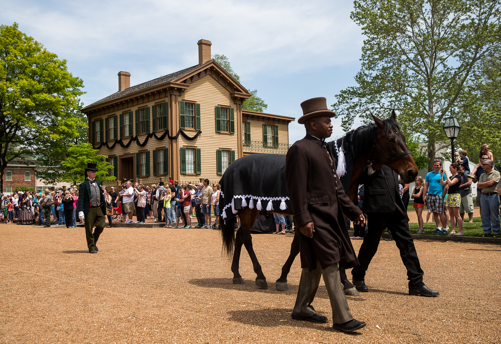 Myrel Simmons portrays Rev. Henry Brown as he leads the horse representing Old Bob by the Lincoln Home during the 2015 Lincoln Funeral Re-enactment, Sunday, May 3, 2015, in Springfield, Ill. Justin L. Fowler/The State Journal-Register