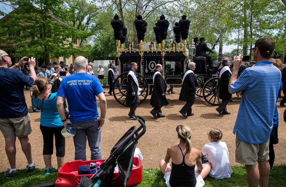 The sides of Eighth Street were lined with visitors as they captured the Lincoln hearse passing by the Lincoln Home on cell phones and cameras during the 2015 Lincoln Funeral Re-enactment, Sunday, May 3, 2015, in Springfield, Ill. Justin L. Fowler/The State Journal-Register