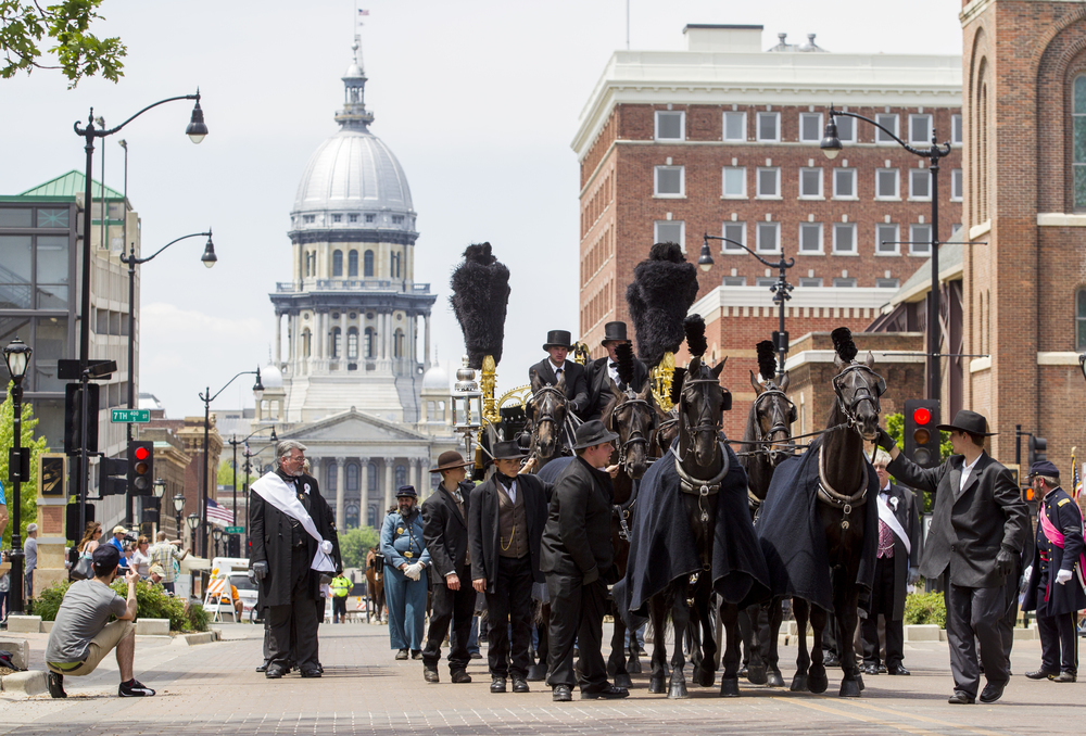 The recreation of the original Lincoln hearse makes it's way east on Capitol Avenue on it's way the Lincoln Home during the 2015 Lincoln Funeral Re-enactment, Sunday, May 3, 2015, in Springfield, Ill. Justin L. Fowler/The State Journal-Register
