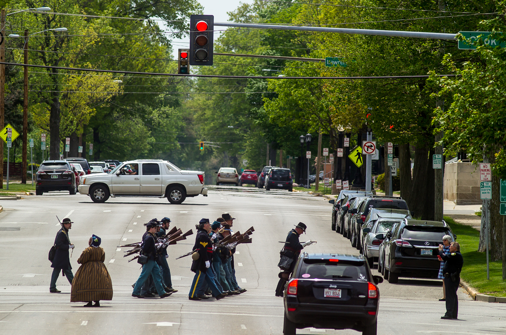 Re-enactors make their way down Cook Street as they cross Seventh Street as traffic is stopped for the funeral procession during the 2015 Lincoln Funeral Re-enactment, Sunday, May 3, 2015, in Springfield, Ill. Justin L. Fowler/The State Journal-Register