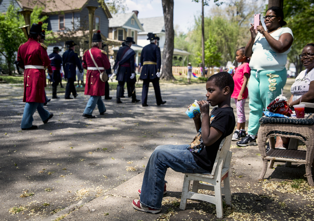 Elijah Altman, 7, takes in the funeral procession as President Lincoln's Own Band passes by during the funeral procession in the 2015 Lincoln Funeral Re-enactment, Sunday, May 3, 2015, in Springfield, Ill. Justin L. Fowler/The State Journal-Register