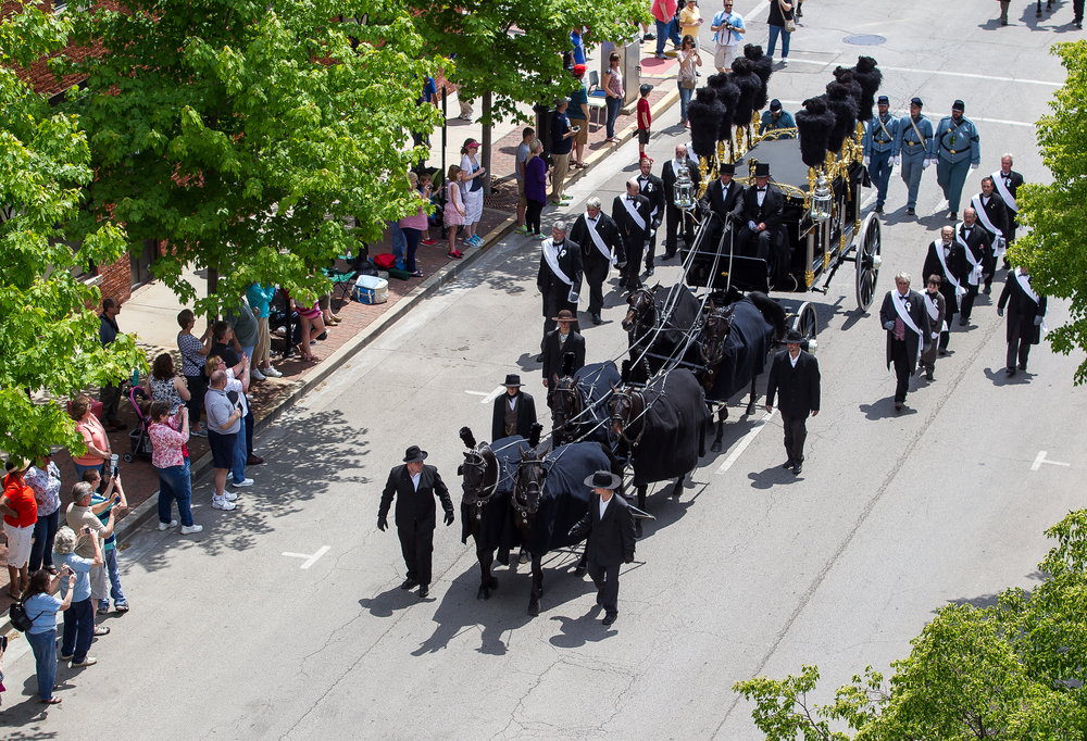 The recreation of the original Lincoln hearse heads north on Fourth Street in the funeral procession during the 2015 Lincoln Funeral Re-enactment, Sunday, May 3, 2015, in Springfield, Ill. Justin L. Fowler/The State Journal-Register