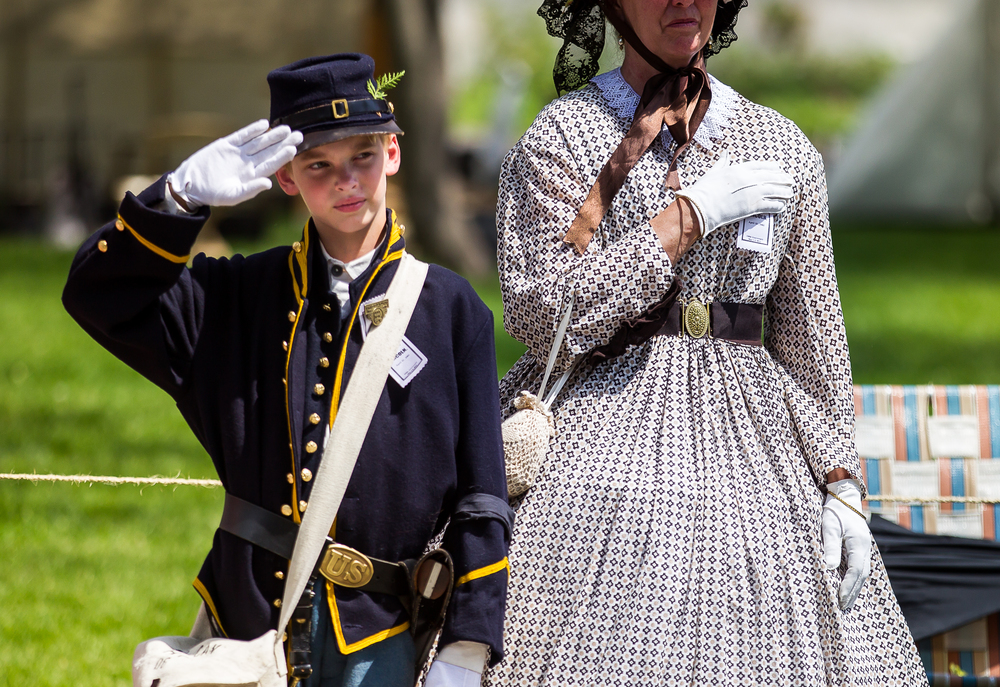 Ian Homeier, of Chatham, Ill., with the 10th Illinois Volunteer Cavalry Regiment, salutes as the funeral procession passes by the Civil War Encampment at Edwards Place during the 2015 Lincoln Funeral Re-enactment, Sunday, May 3, 2015, in Springfield, Ill. Justin L. Fowler/The State Journal-Register