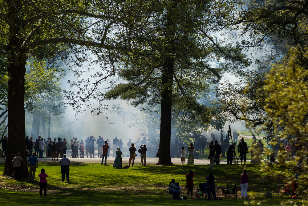 Smoke fills the air of Oak Ridge Cemetery as cannons fire  during the 2015 Lincoln Funeral Re-enactment, Sunday, May 3, 2015, in Springfield, Ill. Justin L. Fowler/The State Journal-Register