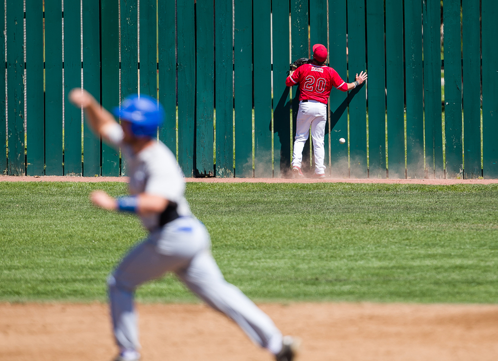 Benedictine outfielder Eric Dodd hits the fence on a two run home run by Williams Baptist's Eric Kent in the third inning during the American Midwest Conference Tournament at Robin Roberts Stadium, Friday, May 1, 2015, in Springfield, Ill. Justin L. Fowler/The State Journal-Register