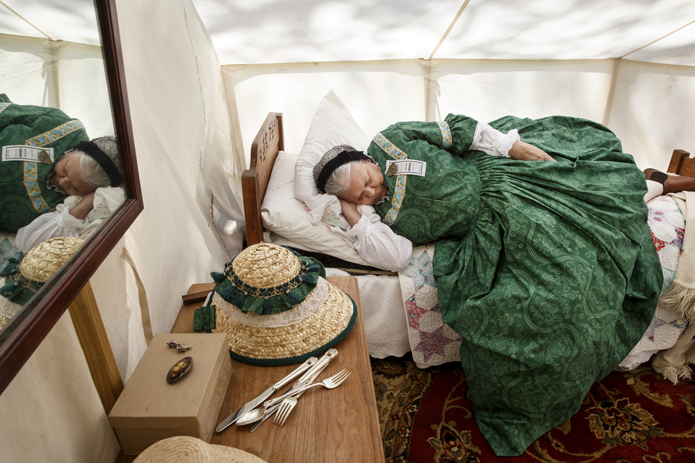 Margaret Felty rests on a cot inside a wall tent at an encampment for the 10th Illinois Volunteer Cavalry Regiment Reactivated on the grounds of the Springfield Art Association Friday, May 1, 2015. Members of the regiment began camping on the grounds Thursday night in preparation for the 150th anniversary of Abraham Lincoln's funeral weekend. Ted Schurter/The State Journal-Register