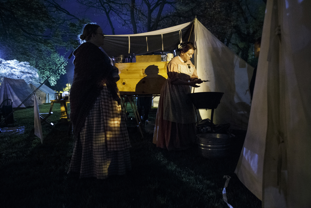 Shea Ingram washes dishes by hand at the encampment of the 10th Illinois Volunteer Cavalry Regiment Reactivated on the grounds of the Springfield Art Association Friday, May 1, 2015. Members of the regiment began camping on the grounds Thursday night in preparation for the 150th anniversary of Abraham Lincoln's funeral weekend. Ted Schurter/The State Journal-Register