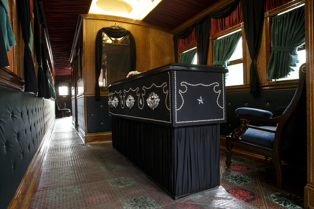 A reproduction of Lincoln's casket rests at one end of of the Lincoln Funeral Car. Ted Schurter/The State Journal-Register