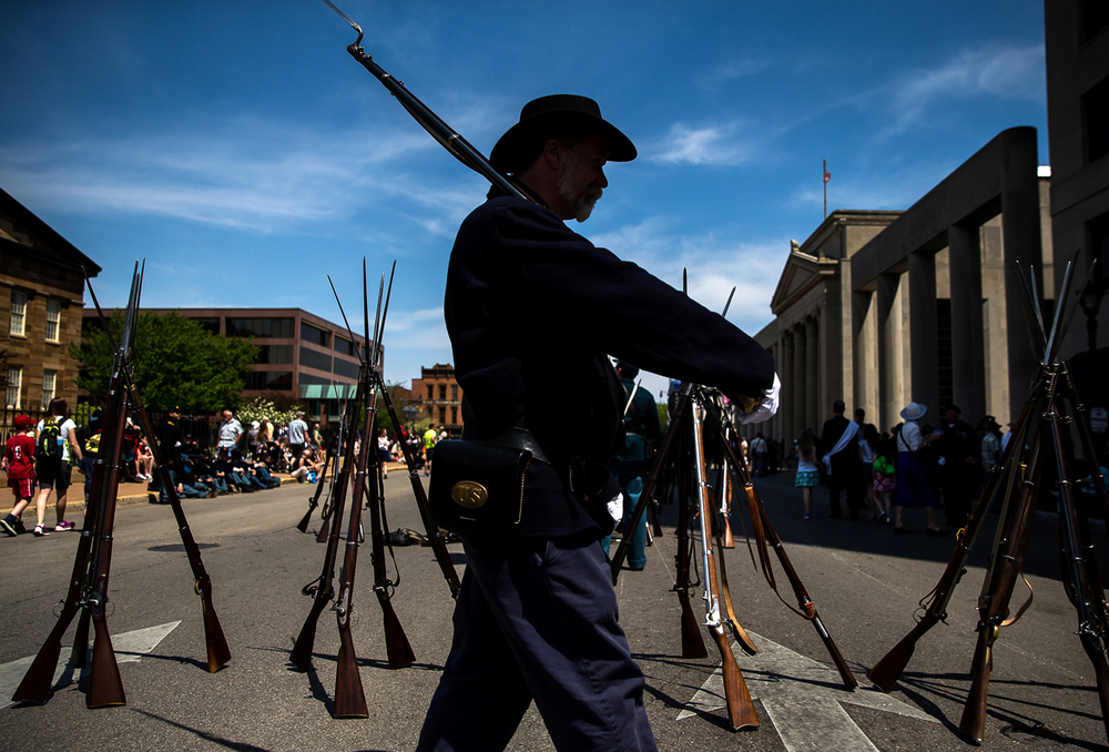Re-enactor Dan Schuda, of Lemont, Ill., 45th Illinois infantry, marches back and fourth in front of the Old State Capitol as he awaits the beginning of the funeral procession during the 2015 Lincoln Funeral Re-enactment, Sunday, May 3, 2015, in Springfield, Ill. Justin L. Fowler/The State Journal-Register