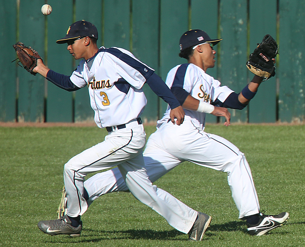 Southeast High School outfielders Maki Gant, left and Dante Williams avoid colliding, and catching a fly ball hit by SH-G's Clayton Taylor Monday, April 27, 2015. The hit resulted in a double for Taylor. David Spencer/The State Journal-Register
