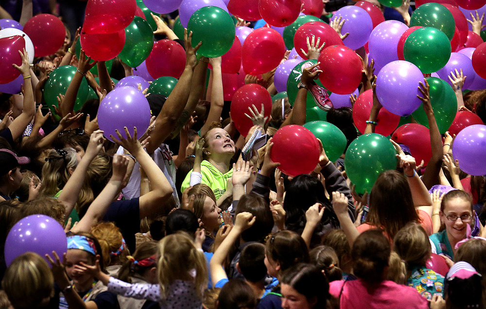 Girl Scouts attending the Girl Expo at the PCCC reach for balloons during the balloon drop at the end of the closing ceremonies Friday afternoon. Girl Scout Day at the Capitol, with over 2000 Girl Scouts from throughout the state attending, took place in Springfield on Friday, May 1, 2015. With the theme of  Land of Lincoln – Past, Present, Future, the event was tied in with the Lincoln Funeral Coalition events taking place this weekend. Along with a morning march to the Capitol building, an afternoon Girl Expo featuring booths and activities with Illinois Governor Bruce Rauner and First Lady Diana Rauner attending the closing ceremonies. David Spencer/The State Journal-Register