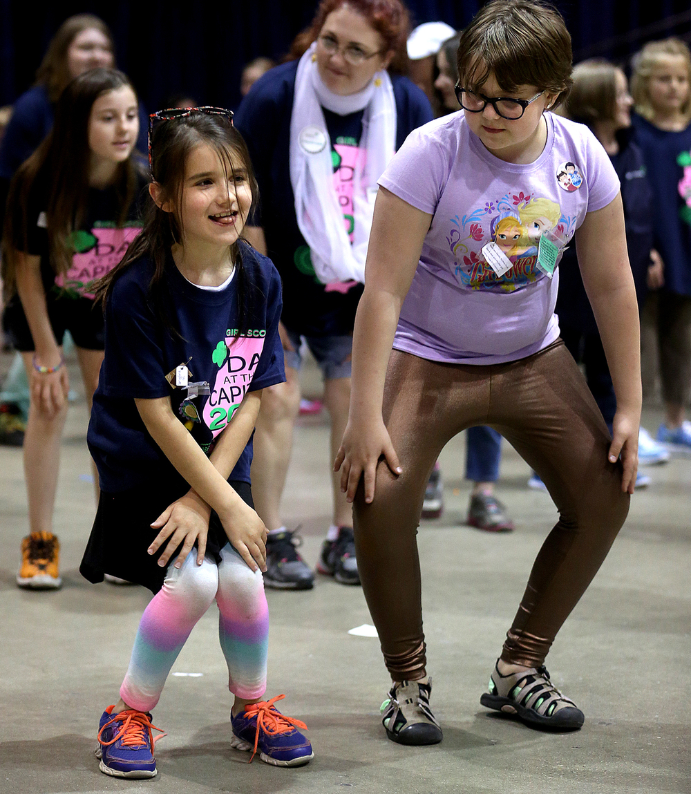 A group dance to the Cha Cha Slide took place during the Girl Expo. Springfield Brownie Troop 6817 members Athia Schleyham at left and Amber Lee take part. Girl Scouts attending the Girl Expo at the PCCC reach for balloons during the balloon drop at the end of the closing ceremonies Friday afternoon. Girl Scout Day at the Capitol, with over 2000 Girl Scouts from throughout the state attending, took place in Springfield on Friday, May 1, 2015. With the theme of  Land of Lincoln – Past, Present, Future, the event was tied in with the Lincoln Funeral Coalition events taking place this weekend. Along with a morning march to the Capitol building, an afternoon Girl Expo featuring booths and activities with Illinois Governor Bruce Rauner and First Lady Diana Rauner attending the closing ceremonies. David Spencer/The State Journal-Register