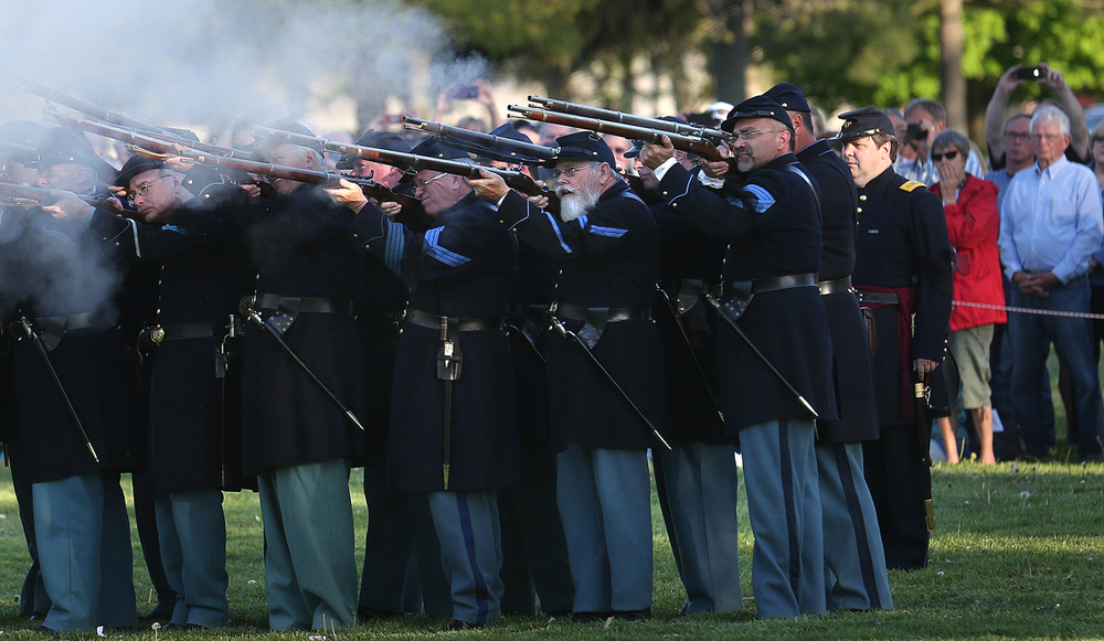 The 114th Regiment Illinois Volunteer Infantry (Reactivated) fire two volleys as well as a cannon shot during a flag retreat ceremony Lincoln's Tomb in Oak Ridge Cemetery on Friday, May 1, 2015. David Spencer/The State Journal-Register
