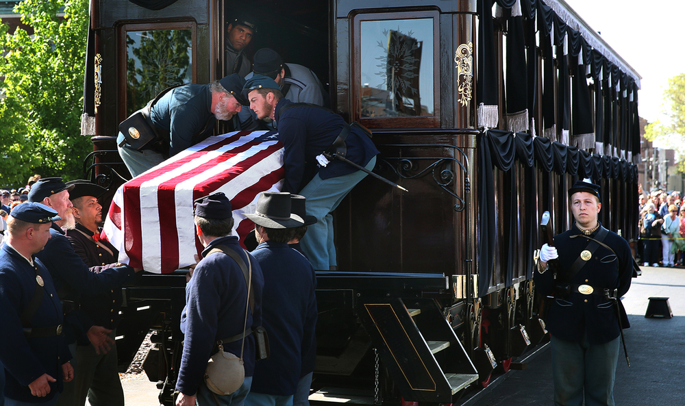 Union soldiers transfer the coffin from the funeral train to begin Saturday's procession. Covering the coffin is a 36-star U.S. flag made by Annin Flagmakers of New York, N.Y., which made the flag that covered Lincoln's coffin in 1865. David Spencer/The State Journal-Register