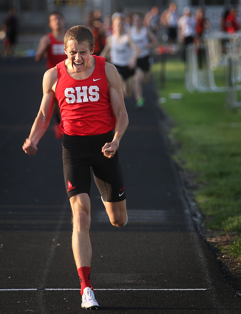 Springfield High School runner Heath Warren celebrates at the finish line after breaking the City Meet record held since 1987 in the 800 meter run with a time of 1:53.22. The Boys City Track Meet took place at Memorial Stadium in Springfield on Tuesday, May 5, 2015. David Spencer/The State Journal-Register