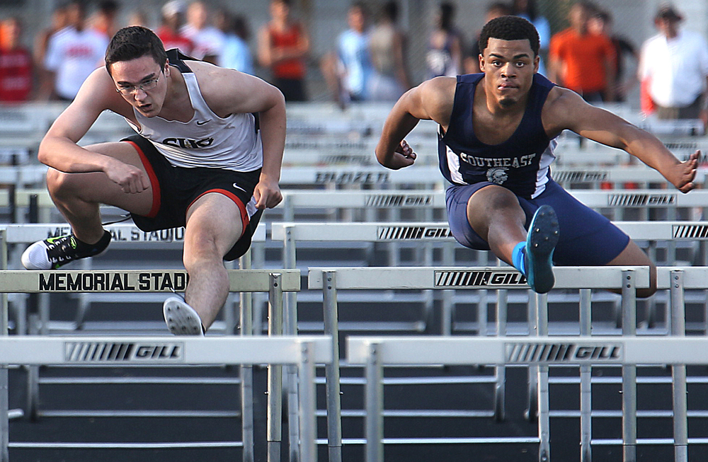 Springfield Southeast High School hurdler Edwin Gailes at right nudged out SHG hurdler Nick Mucciante to win the 110 meter race in 16.24. Mucciante ran 16.26. The Boys City Track Meet took place at Memorial Stadium in Springfield on Tuesday, May 5, 2015. David Spencer/The State Journal-Register