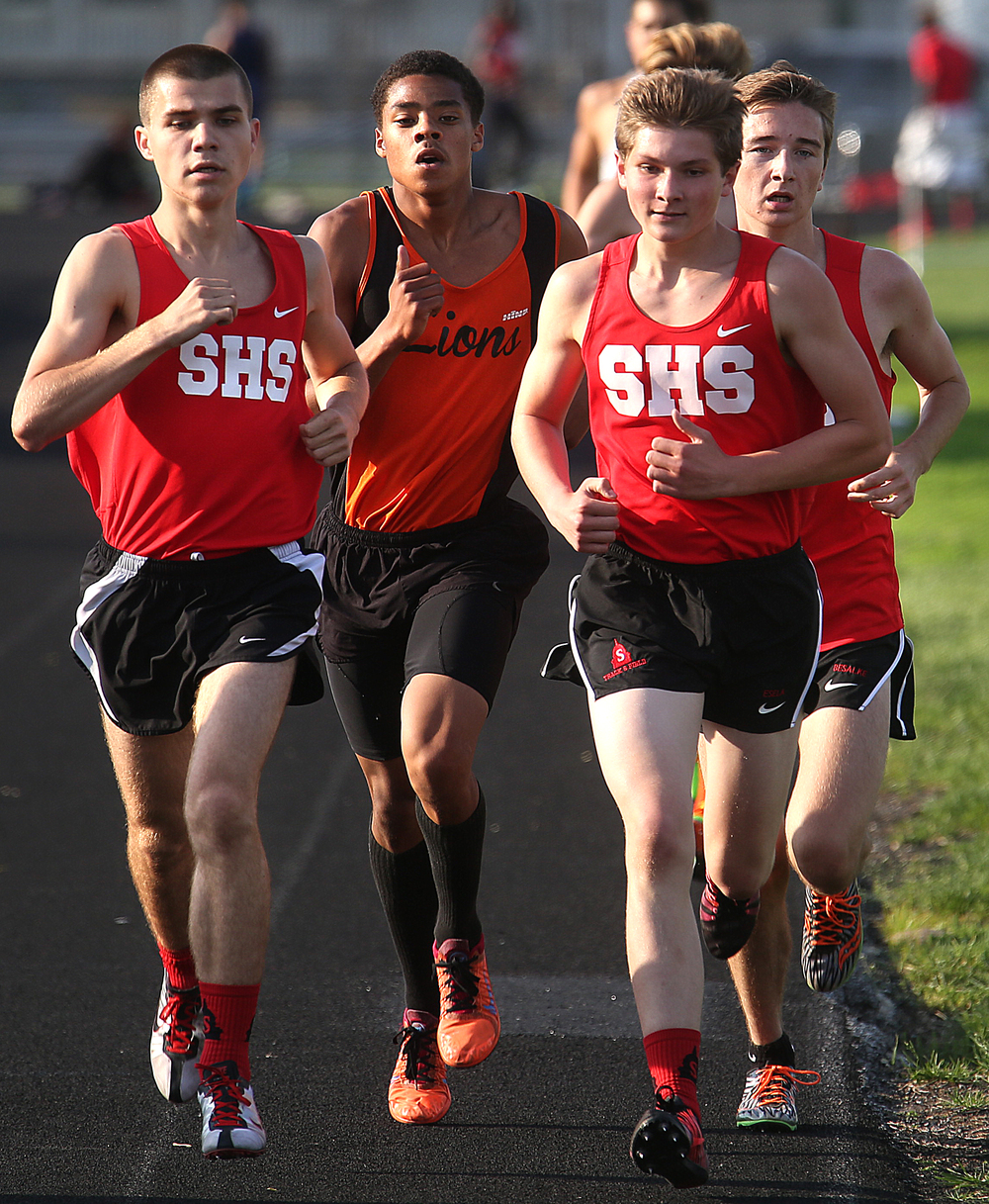 Springfield High School runner Michael Neposchlan at left won the 3200 meter run in a time of 10:15.57. Lanphier's Kevin Stewart to rear of Neposchlan came in second with a time of 10.18.75. The Boys City Track Meet took place at Memorial Stadium in Springfield on Tuesday, May 5, 2015. David Spencer/The State Journal-Register