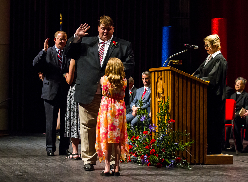 Ward 8 Ald. Kris Theilen takes the Oath of Office with the help of his daughter, Katie, along with Ward 7 Ald. Joe McMenamin during the City of Springfield 2015 Inaugural Ceremony at the Sangamon Auditorium, Thursday, May 7, 2015, in Springfield, Ill. Justin L. Fowler/The State Journal-Register