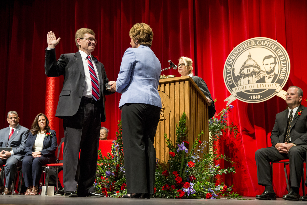 Jim Langfelder takes the Oath of Office from the Honorable Leslie J. Graves as his wife, Billie, holds the Bible during the City of Springfield 2015 Inaugural Ceremony at the Sangamon Auditorium, Thursday, May 7, 2015, in Springfield, Ill. Justin L. Fowler/The State Journal-Register