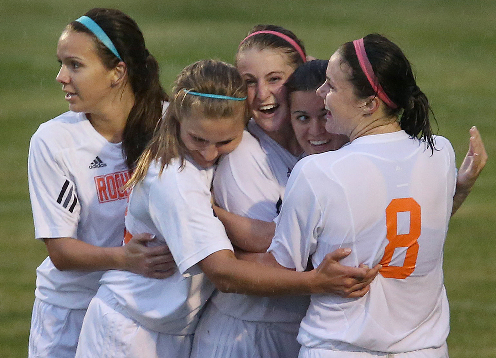 Rochester was declared offside moments after players celebrate a goal made by teammate Becca Jostes in the second period which did not count. With neither team scoring, a weather delay with 8:45 remaining in the game forced the suspension of play between Rochester and Chatham Glenwood in girls high school soccer action at Rochester Elementary School on Thursday evening, May 7, 2015. David Spencer/The State Journal-Register
