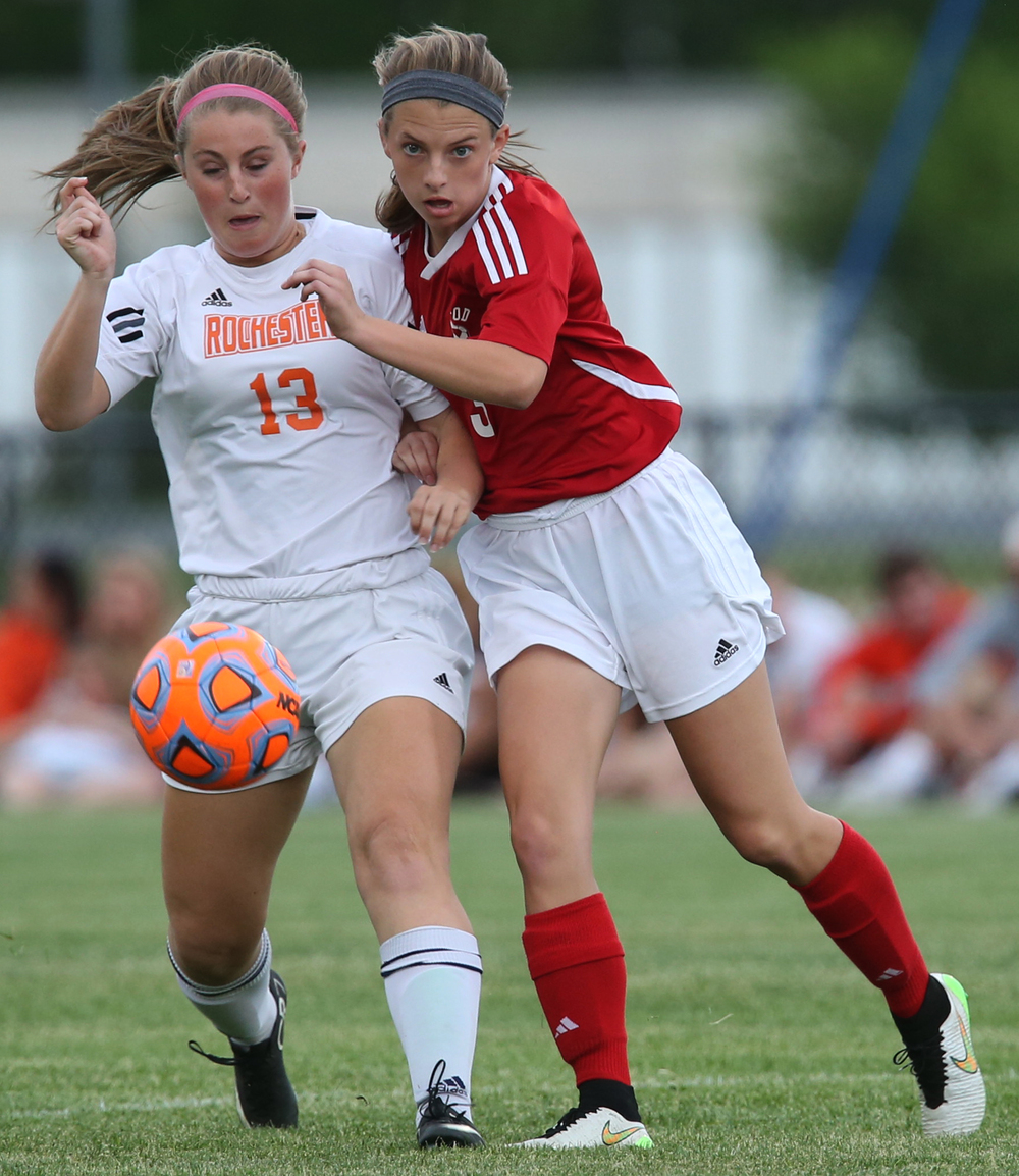 Glenwood player Katie Juhlin challenges Rochester's Baylee Smith for the ball during first period action. With neither team scoring, a weather delay with 8:45 remaining in the game forced the suspension of play between Rochester and Chatham Glenwood in girls high school soccer action at Rochester Elementary School on Thursday evening, May 7, 2015. David Spencer/The State Journal-Register