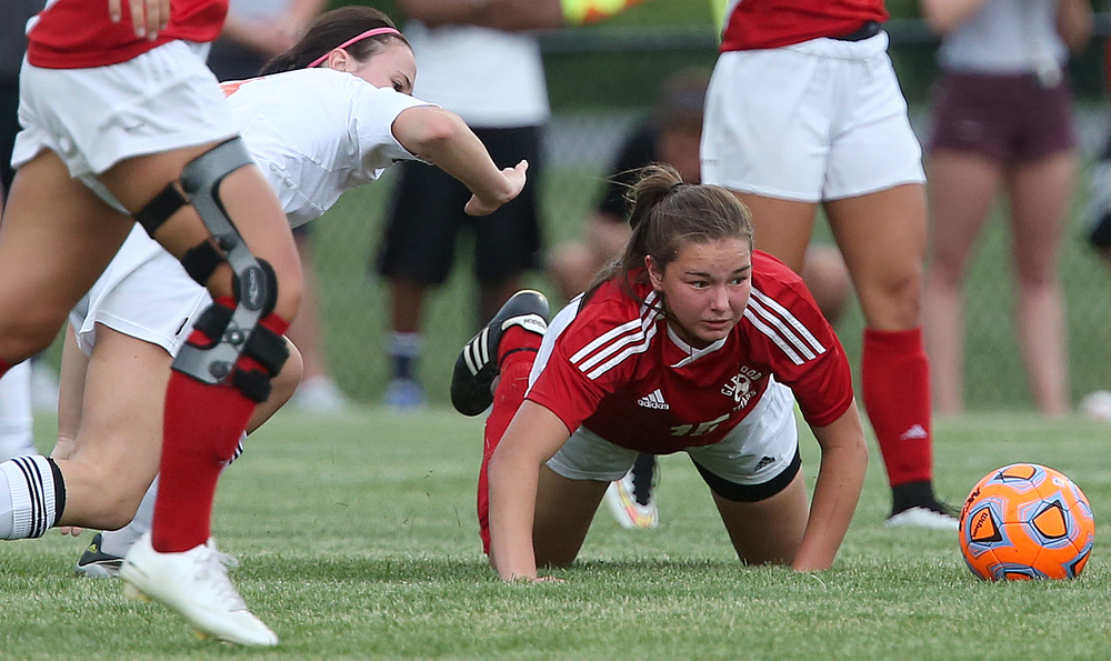 Glenwood player Alie Smith keeps her eye on the ball after ending up on the ground while pursuing the ball during first period action. With neither team scoring, a weather delay with 8:45 remaining in the game forced the suspension of play between Rochester and Chatham Glenwood in girls high school soccer action at Rochester Elementary School on Thursday evening, May 7, 2015. David Spencer/The State Journal-Register