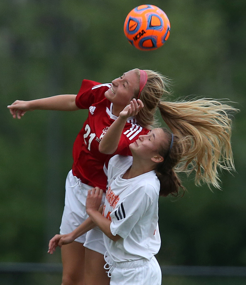 Glenwood player Kennedy Sheedy gets her head on the ball while Rochester player Riley Ross also gets in on the action during first period action. With neither team scoring, a weather delay with 8:45 remaining in the game forced the suspension of play between Rochester and Chatham Glenwood in girls high school soccer action at Rochester Elementary School on Thursday evening, May 7, 2015. David Spencer/The State Journal-Register