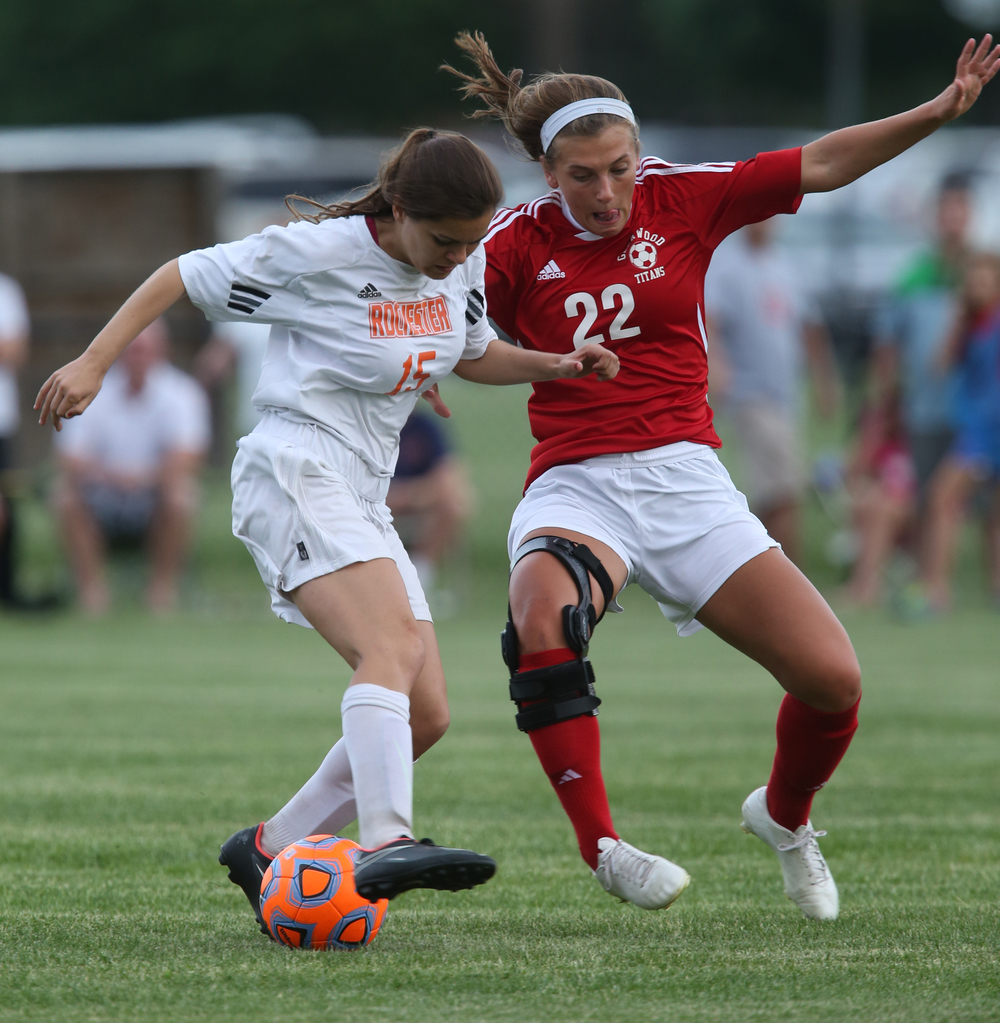 Glenwood player Alie Smith at left and Rochester's Mandy Yeck mix it up during first period action. With neither team scoring, a weather delay with 8:45 remaining in the game forced the suspension of play between Rochester and Chatham Glenwood in girls high school soccer action at Rochester Elementary School on Thursday evening, May 7, 2015. David Spencer/The State Journal-Register