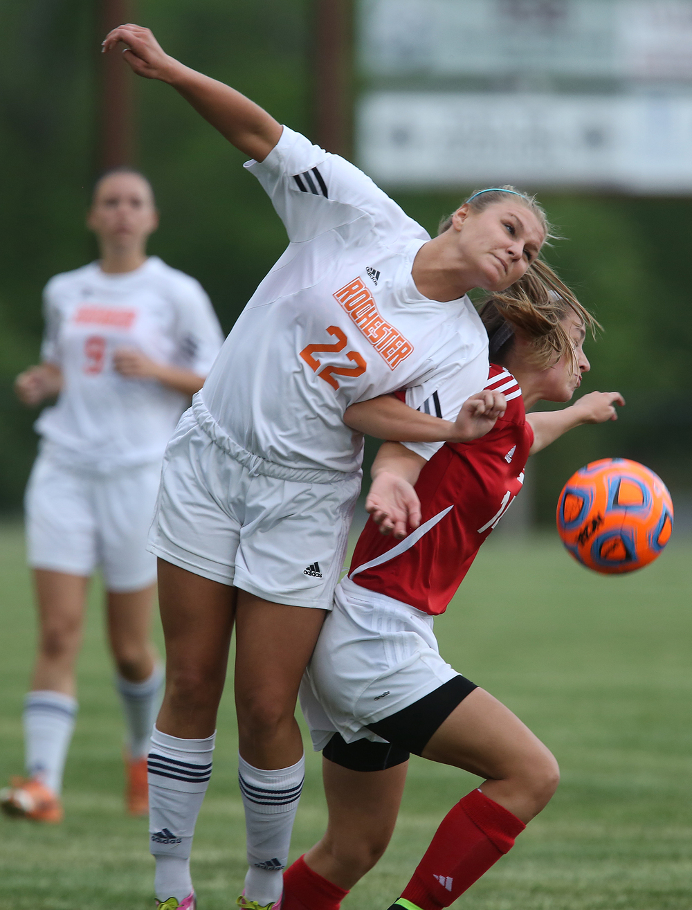 Rochester player Mandy Yeck and Glenwood's Demi Dixon battle for the ball during first period action. With neither team scoring, a weather delay with 8:45 remaining in the game forced the suspension of play between Rochester and Chatham Glenwood in girls high school soccer action at Rochester Elementary School on Thursday evening, May 7, 2015. David Spencer/The State Journal-Register
