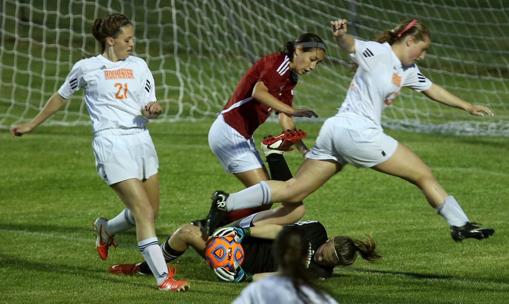 Glenwood goalkeeper Mara Cunningham makes a save over leaping Rochester player Baylee Smith in the second period. With neither team scoring, a weather delay with 8:45 remaining in the game forced the suspension of play between Rochester and Chatham Glenwood in girls high school soccer action at Rochester Elementary School on Thursday evening, May 7, 2015. David Spencer/The State Journal-Register