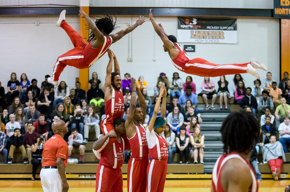 The Jessie White Tumbling Team perform their high flying acrobatic performance in front of students from Lanphier High School during an assembly at Lober-Nika Gymnasium, Monday, April 6, 2015, in Springfield, Ill. Illinois Secretary of State Jesse White spoke to the students about the responsibilities they have as young drivers and that his office can revoke driver licenses for those that loose their driving privileges. Justin L. Fowler/The State Journal-Register