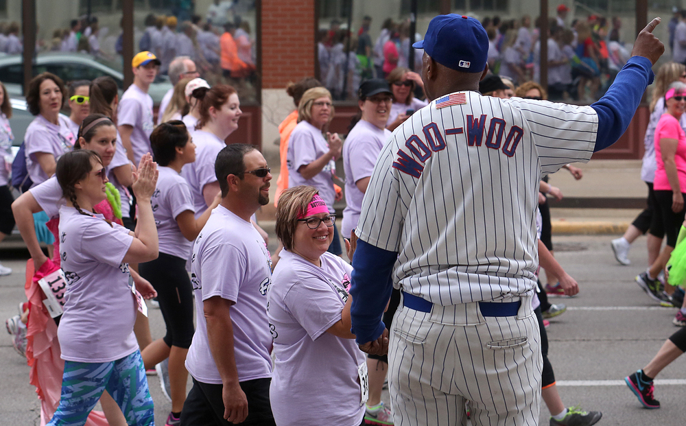 "Longtime Chicago Cubs fan and celebrity Ronnie ""Woo Woo"" Wickers of Chicago made an appearance along Monroe Street, pointing the way for runners while he wasn't getting his photo taken with participants. David Spencer/The State Journal-Register"