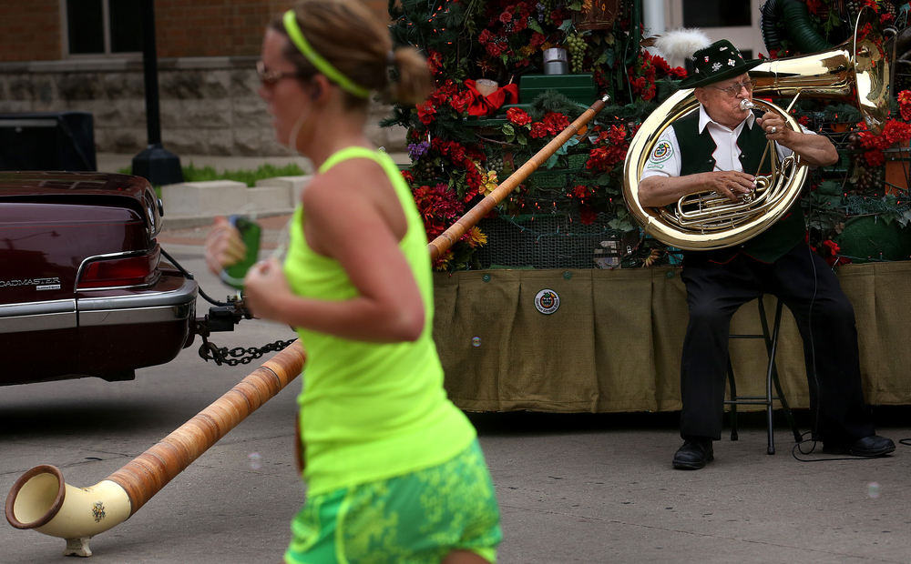 Harry Wolf with the Waterloo German Band from Waterloo, Ill. had his alpenhorn set up during the race along Capitol Avenue.  David Spencer/The State Journal-Register