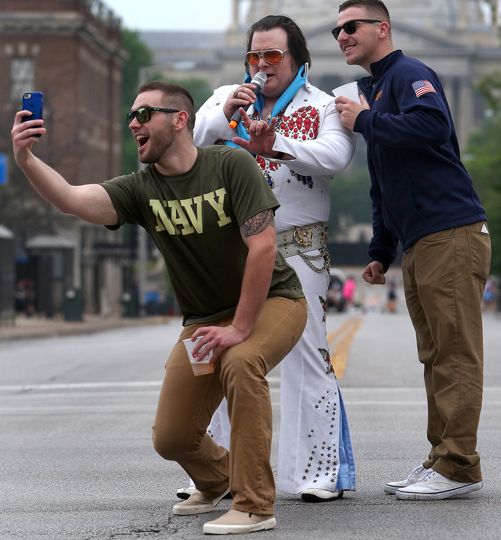 "Elvis Presley interpreter Rick ""Elvis Himselvis"" Dunham of Springfield was getting a lot of attention while singing on Capitol Avenue during the race. David Spencer/The State Journal-Register"