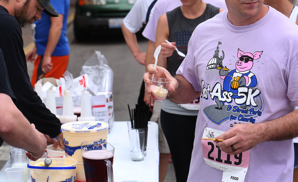 The Craft Beer Bar in downtown Springfield was handing out blackberry cider ice cream floats to runners. David Spencer/The State Journal-Register
