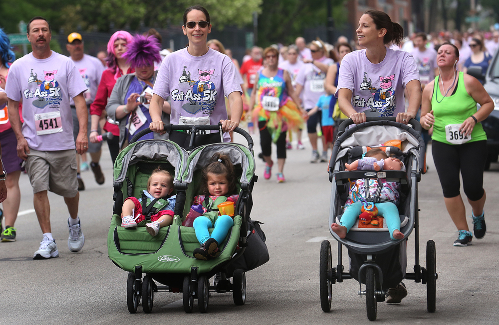Courtesy of moms, young participants did the 5k in style along Fourth Street. David Spencer/The State Journal-Register