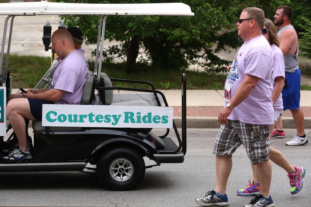 And for those needing a little help, a golf cart offered courtesy rides to runners along the route, with this being spied along Fourth Street. David Spencer/The State Journal-Register