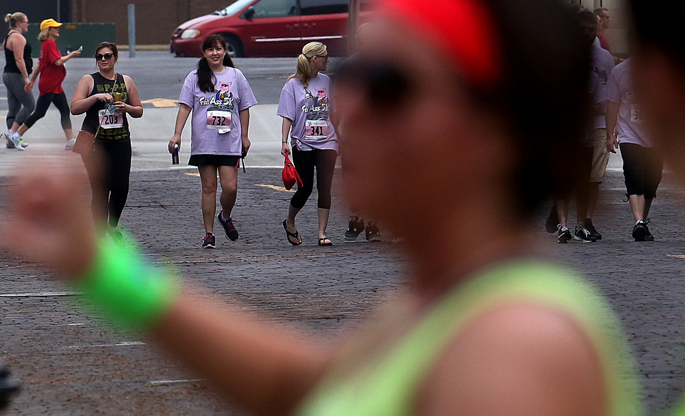 "Participants use a cut-through on Jackson St. north of the Executive Mansion to make up a bit of time during the ""race.""  David Spencer/The State Journal-Register"