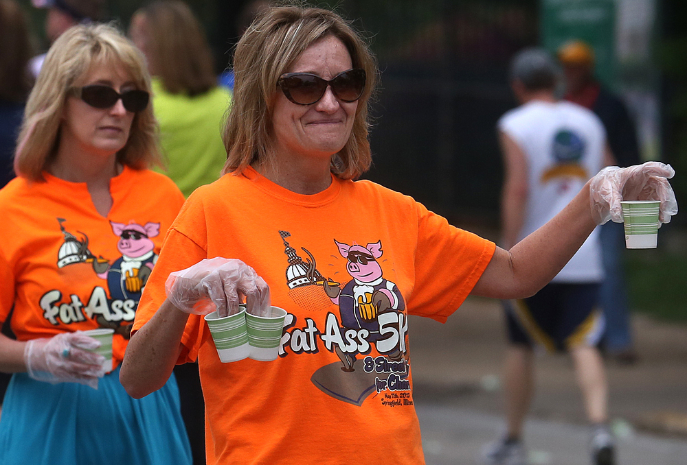 Beer was plentiful along the race route, but reality dictated hydration called for water. Volunteers had plenty for participants set up across from the Executive Mansion along Fourth Street. David Spencer/The State Journal-Register