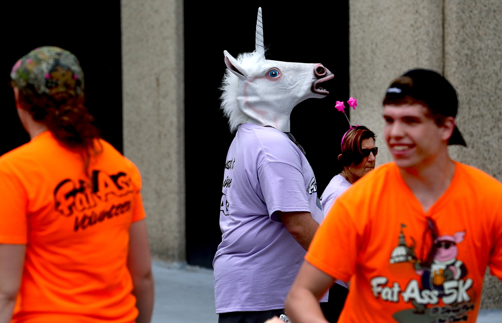 Unconventional race apparel included one gentleman sporting a unicorn mask. David Spencer/The State Journal-Register