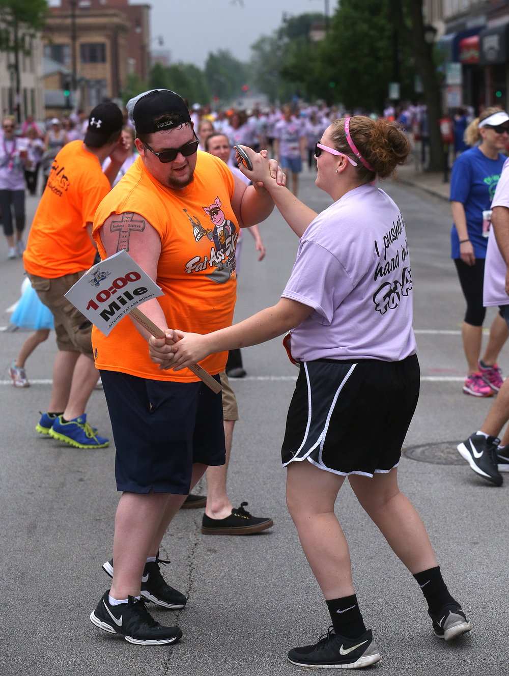 Volunteers break out in dance along the race route downtown.  David Spencer/The State Journal-Register