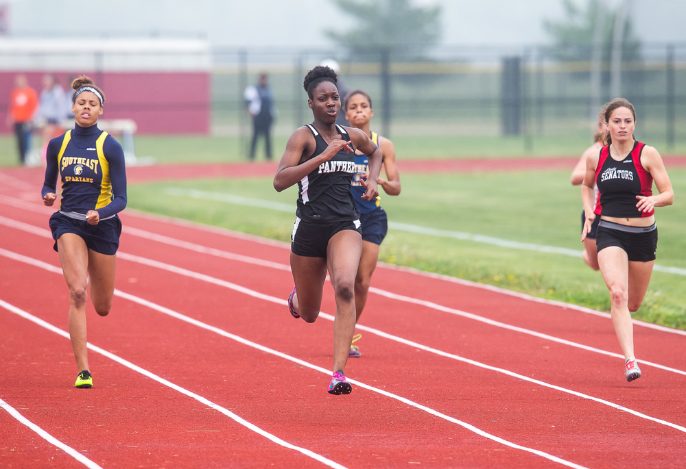 Decatur Eisenhower's Tina Martin heads to the front on her way to wining the 200m Dash with a time of 26.08 during the Girls Central State Eight Conference Track Meet at Glenwood High School, Saturday, May 9, 2015, in Chatham, Ill. Justin L. Fowler/The State Journal-Register